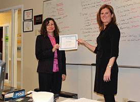 Rachel Hopkins receiving certificate