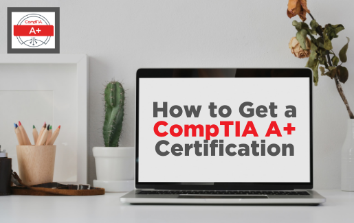 """Desk with a mini cactus plant, bowl of colored pencils, and laptop with screen reading """"How to get a CompTIA A+ certification"""""""