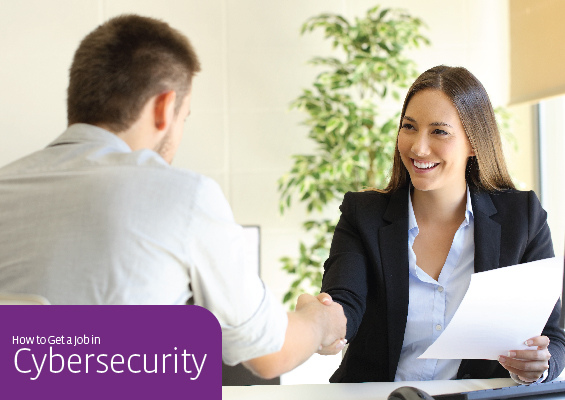 An IT pro shakes hands with a hiring manager during an interview for a cybersecurity job