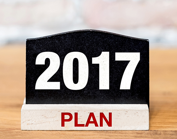 A sign on a desk that says '2017 Plan'