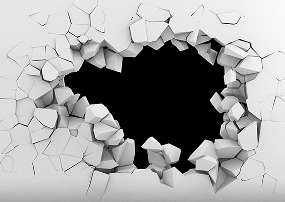 A hole punched in a wall