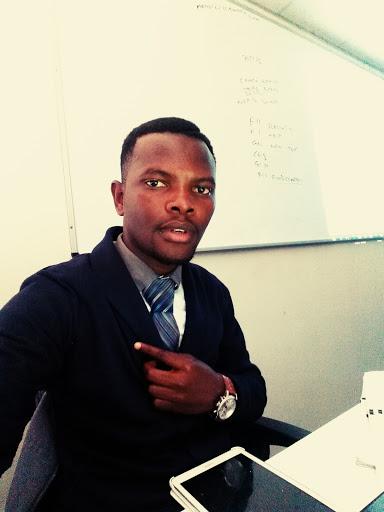 Clinton Melusi in the classroom, preparing to teach