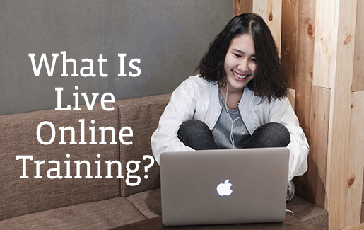 A woman uses a laptop and earbuds to participate in live online training from home