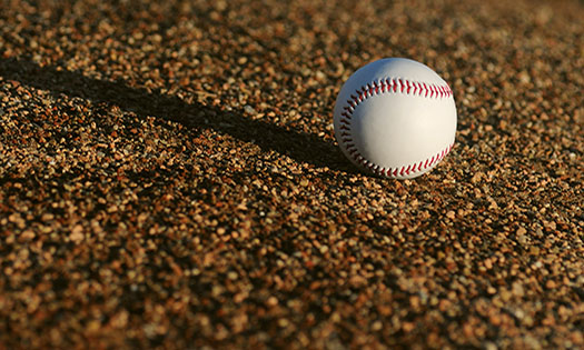 A baseball on the field, comparing sign stealing to cyber threat intelligence and threat modeling