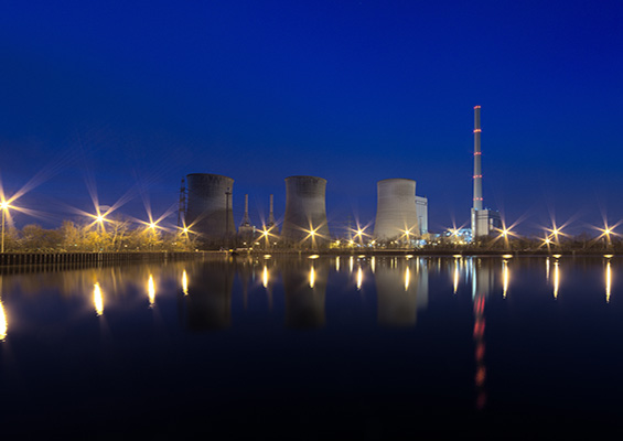 A photo of a nuclear power plant at night