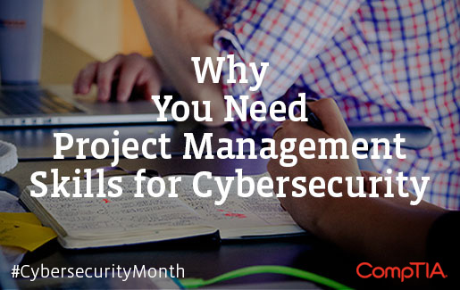 A cybersecurity professional uses a laptop, notebook and phone for project management