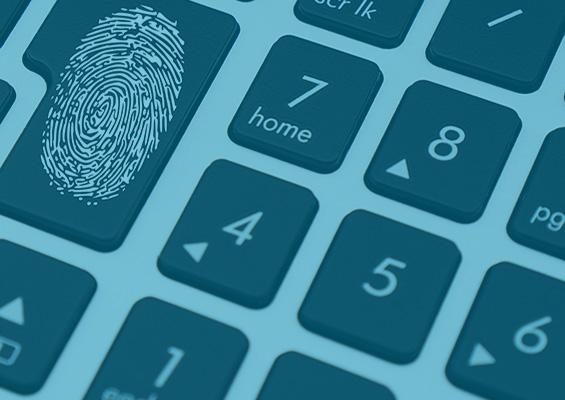 A thumbprint on a keyboard