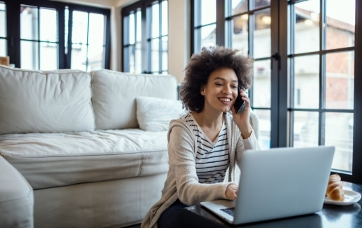 Woman working from home at coffee table.