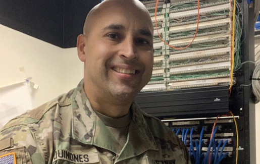 Henry Quinones at work in IT for the Army