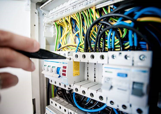 A person works on the cables in a server room