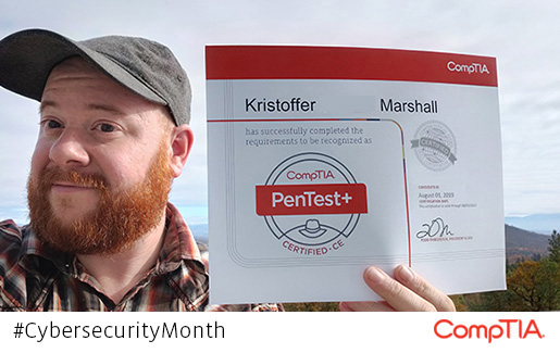Kristoffer Mashall holds up his CompTIA PenTest+ certification