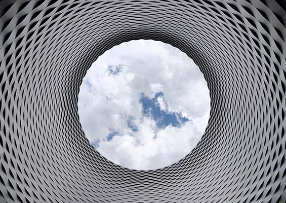 Clouds in the sky viewed through a circular opening