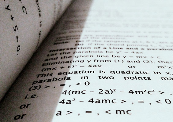 A book open to a math equation