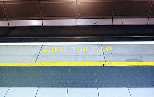 """A photo from the London Tube that says """"Mind the Gap"""""""