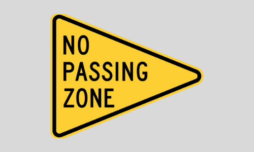 A street sign that says no passing zone.