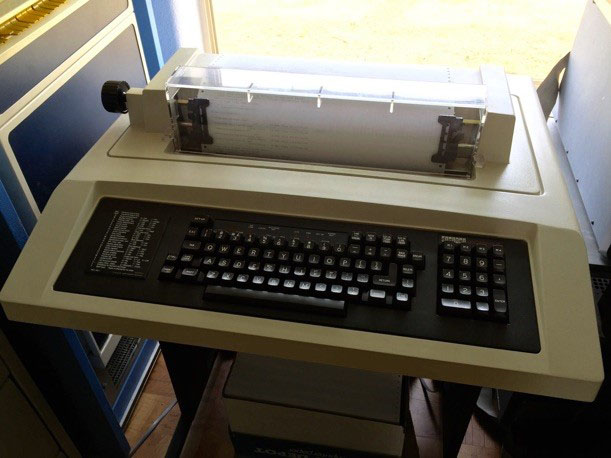 A photo of an old UNIX terminal that looks like a printer with a keyboard