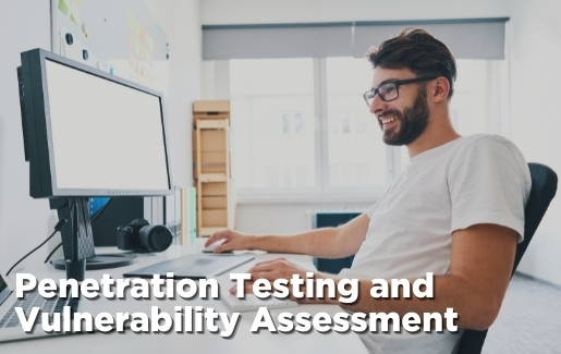 Man working on computer with the text Penetration Testing and Vulnerability Assessment