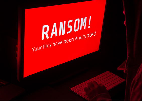 A person at a computer sees a ransomware warning saying his files have been encrypted