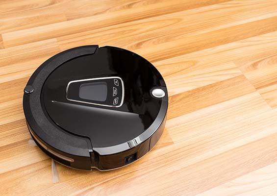 A Roomba on a hardwood floor
