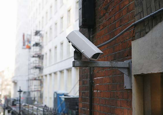 A closed-circuit security camera on a city street.