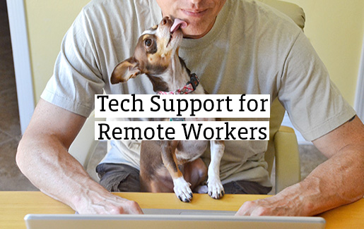 A help desk technician works from home with his dog in his lap