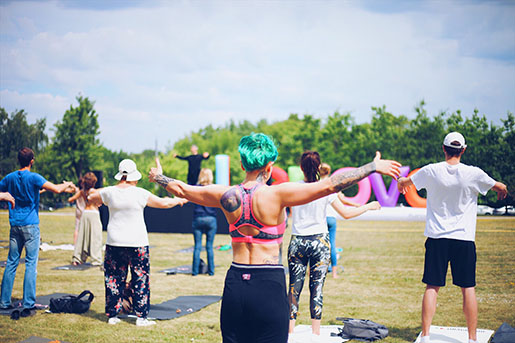 People do yoga in a park in Washington, D.C.