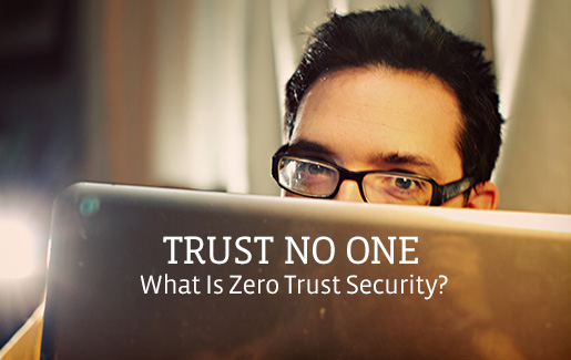 """A man peeks over the top of his laptop, and the words read, """"Trust no one: What is zero trust security?"""""""