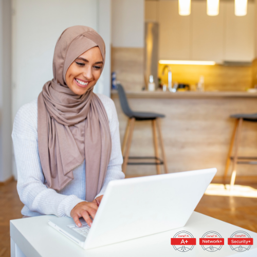 Woman in head wrap on computer
