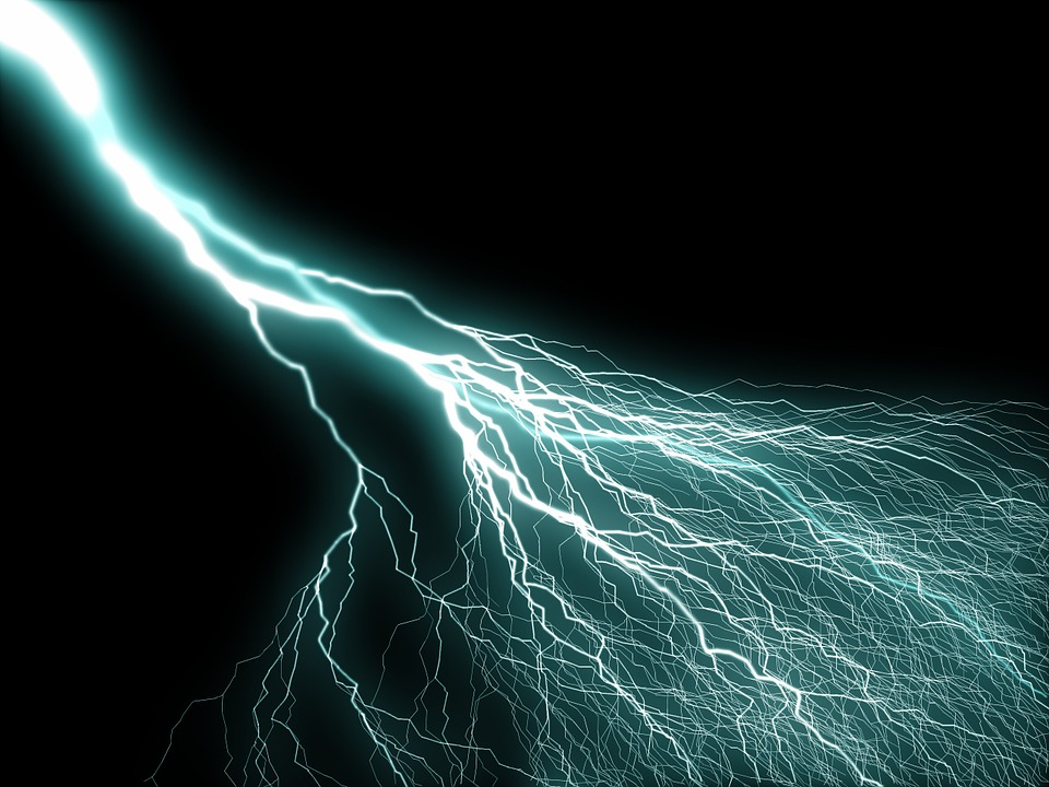 A photo of a blue electric current over a black background.
